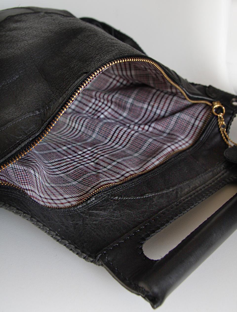 世界に一つ黒本革パッチワークのクラッチバッグ。中はロンドンモードなチェック柄☆